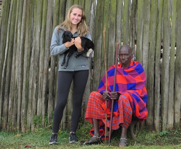Maasai man and girl holding a goat.
