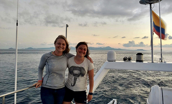 Sisters on a boat in the Galapagos.