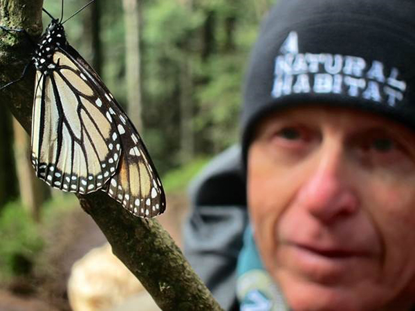 Natural Habitat traveler with monarch.