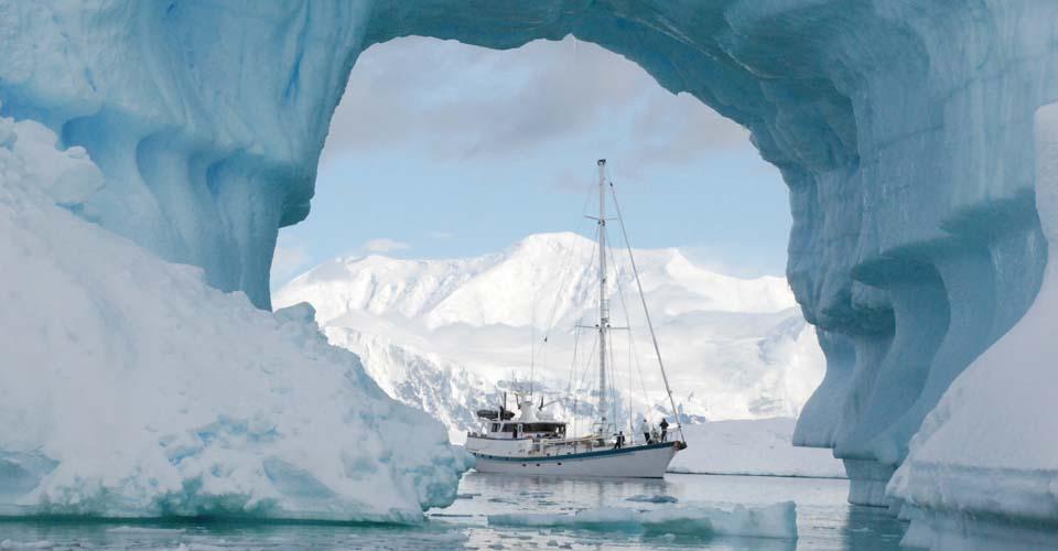 S/V Australis, Iceberg arch, Antarctic Peninsula