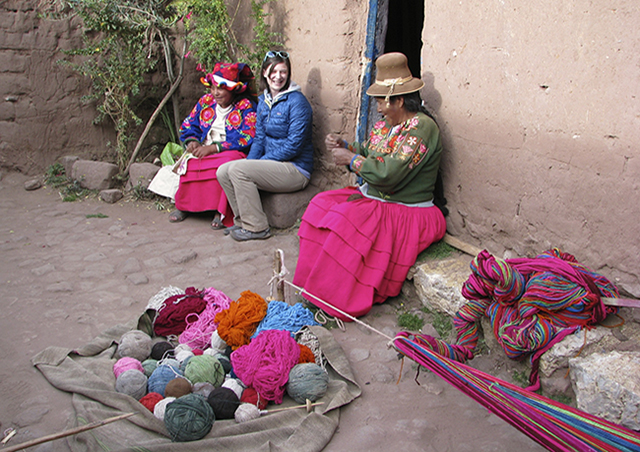 Learning about the colorful weavings of the Lake Titicaca region of Peru.