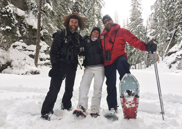 Snowshoeing up a ravine with Natural Habitat Adventures Expedition Leaders, Paul Brown and Kevin Taylor, in Yellowstone National Park