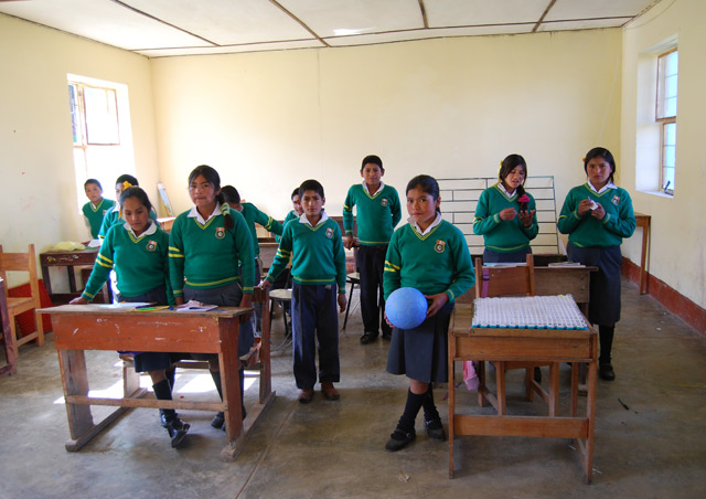 I donated a ball to the school children in a village outside of Huaraz, Peru.  This community is at about 12,000 feet and it's so impressive to watch the kids run at that elevation.  The boys dubbed it a soccer ball and the girls quickly countered by calling it a volleyball.  Check out this great organization: http://www.oneworldfutbol.com/