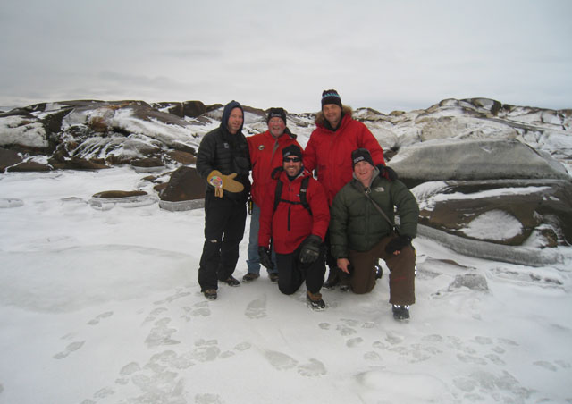 In Churchill, Ben gathers on the ice with some of the field staff. If you look closely you'll see polar bear tracks!