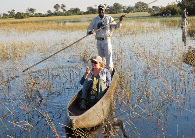 "Traveling by mokoro with my local guide, ""G"", in the Okavango Delta, Botswana."