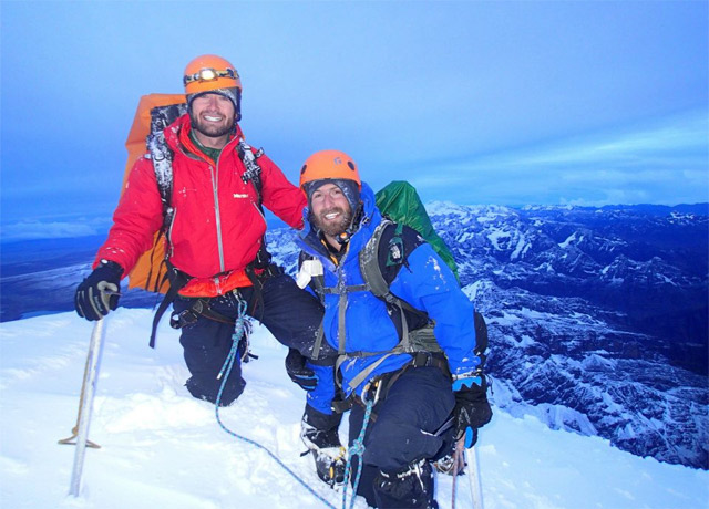 Delirious but still smiling atop 6,088-meter Huayna Potosi in Bolivia with his best friend Adam in December of 2012.