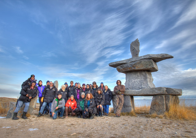 Group photo at the famous inukshuk on the edge of the Hudson Bay, Churchill