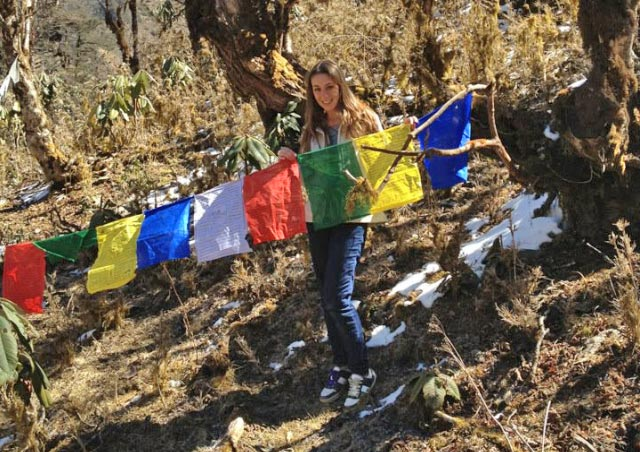 Hanging prayer flags at the top of Phobjikha Valley in Bhutan.