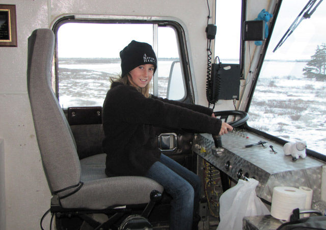 My Daughter, Grace, behind the wheel of a Polar Rover.