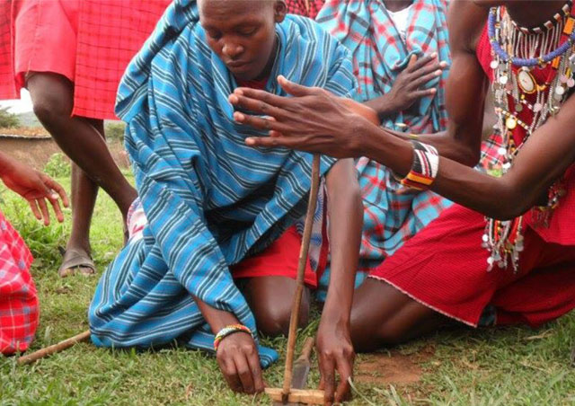Maasai tribesman showing a traditional fire-starting method.