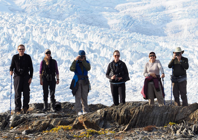 A few of us from my trip to Greenland took a break from the Zodiacs to hike to a great view of the Greenland ice sheet. Photo Credit: Eric Rock