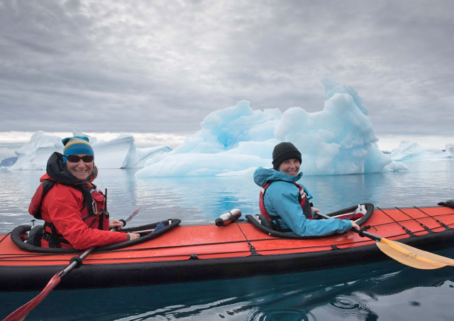 Kayaking among the icebergs in Greenland. Photo credit: Colby Brokvist