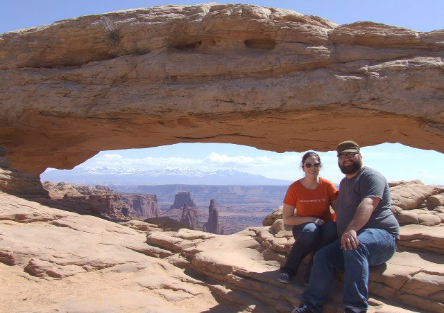 Kit and her sweetheart, Davis, enjoy the views at Mesa Arch in Utah.