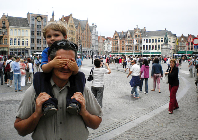 "Layovers en-route to Africa are a great way to ""see"" Europe. My son, Nile, makes sure I ""see no evil"" in Brussels, Belgium."