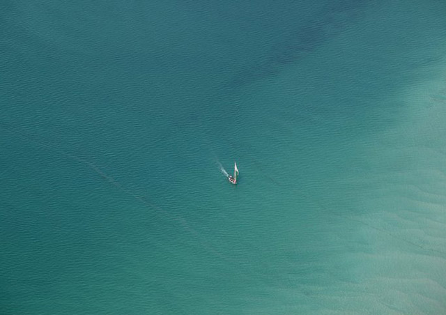 Traditional dhow boat off the coast of Mozambique - a great extension to safari!