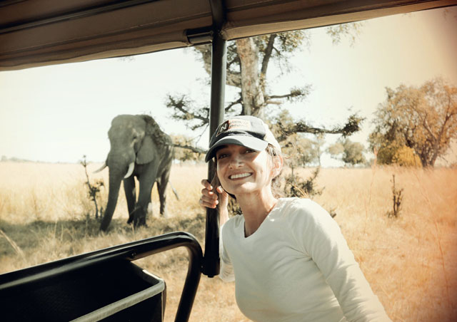 In the Okavango Delta, Botswana, with a curious elephant.