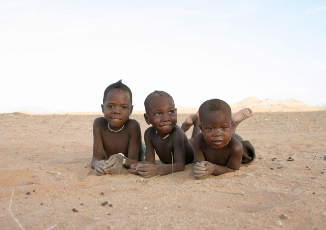 Rolling around in the sand with Himba boys at Serra Cafema in Namibia's far northern reaches.