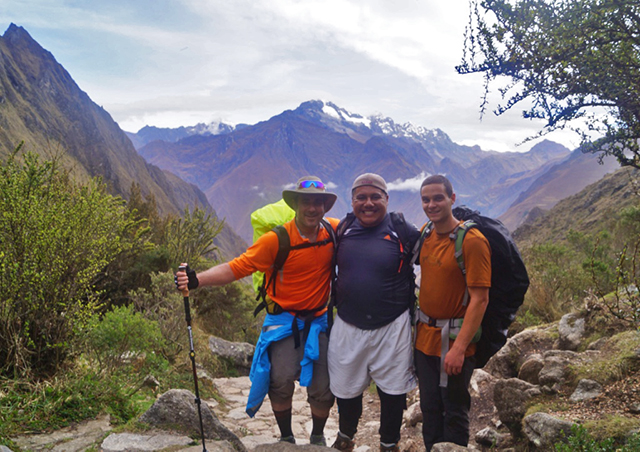 Hiking up the first ascent along the Inca trail from Cusco to Machu Picchu in Peru, with Veronica peak in the background.