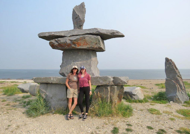 Suzanne with her daughter, Malia at the iconic inuksuk along the shore of the Hudson Bay.