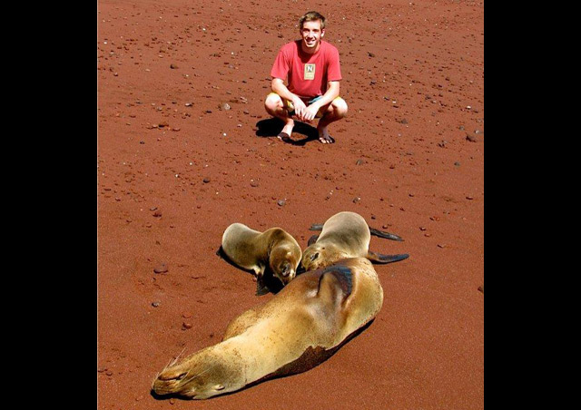 My son Kevin with sea lion mom and pups.