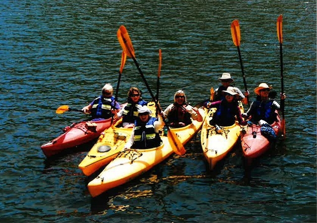 Kayaking the Duoro River in Portugal with a small group of Nat Hab travelers.
