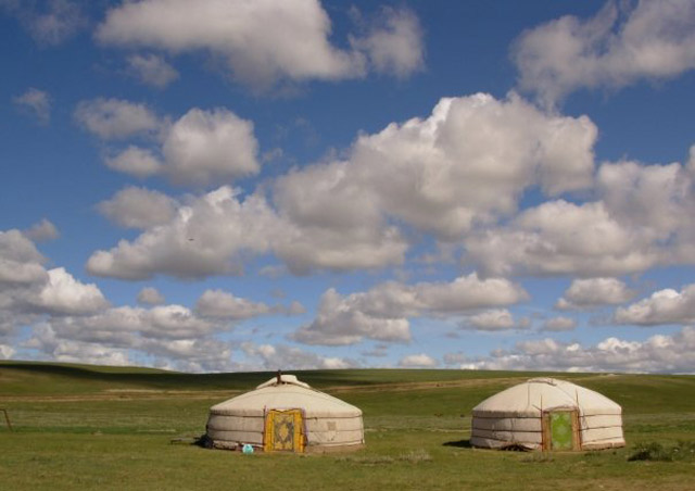 About half of Mongolia's population are nomads, living in round white felt gers and moving seasonally with their flocks and herds.