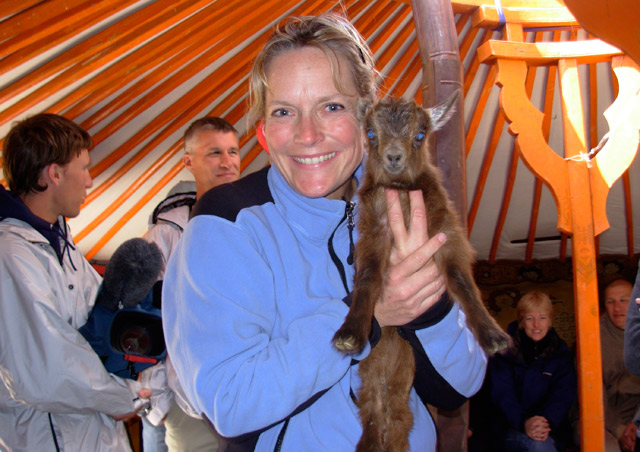 Here I am inside a traditional Mongolian ger, holding a baby goat that's just a few days old.