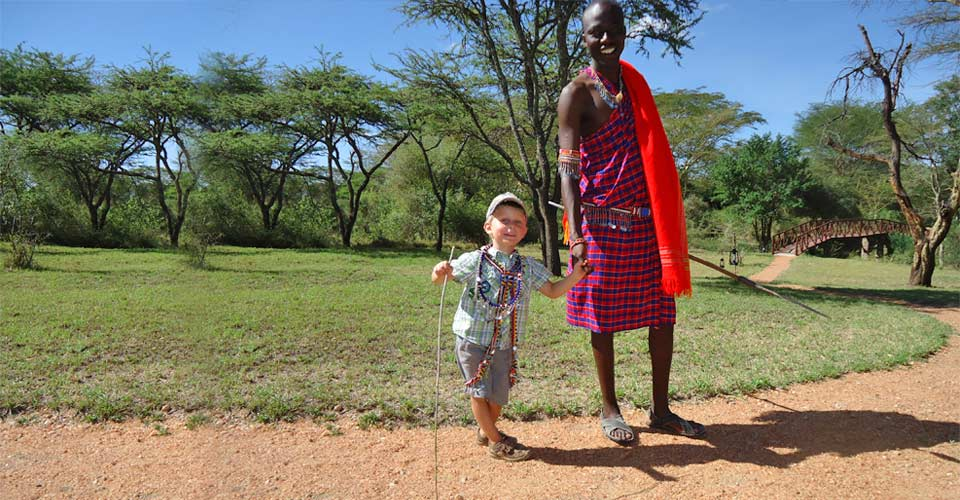 Maasai warrior with child, Maasai Mara, Kenya