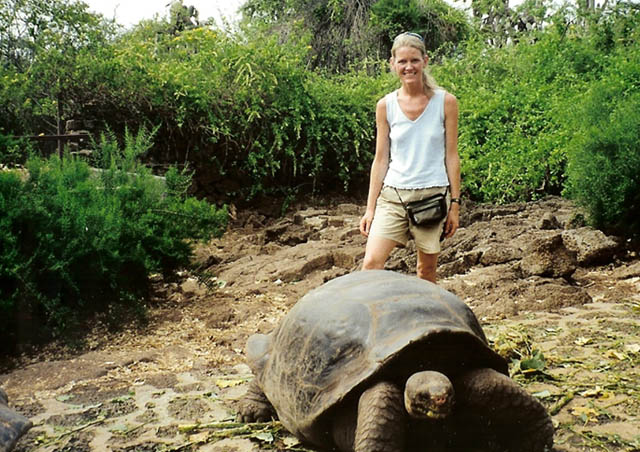 Posing with Lonesome George at the Charles Darwin Research Center, Galapagos Islands.