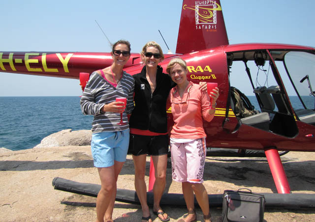Our helicopter pilot landed on a rock in Lake Tanganyika, Tanzania for a celebratory champagne stop after floating weightlessly over Kalambo Falls!