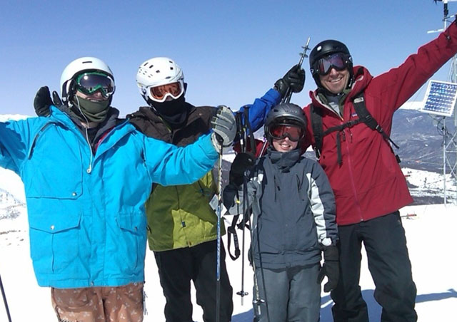 The skiing in Colorado is world class. Here Ben, his two sons and a friend climb to the top of Breckenridge Mountain to enjoy some great views and some fresh powder.