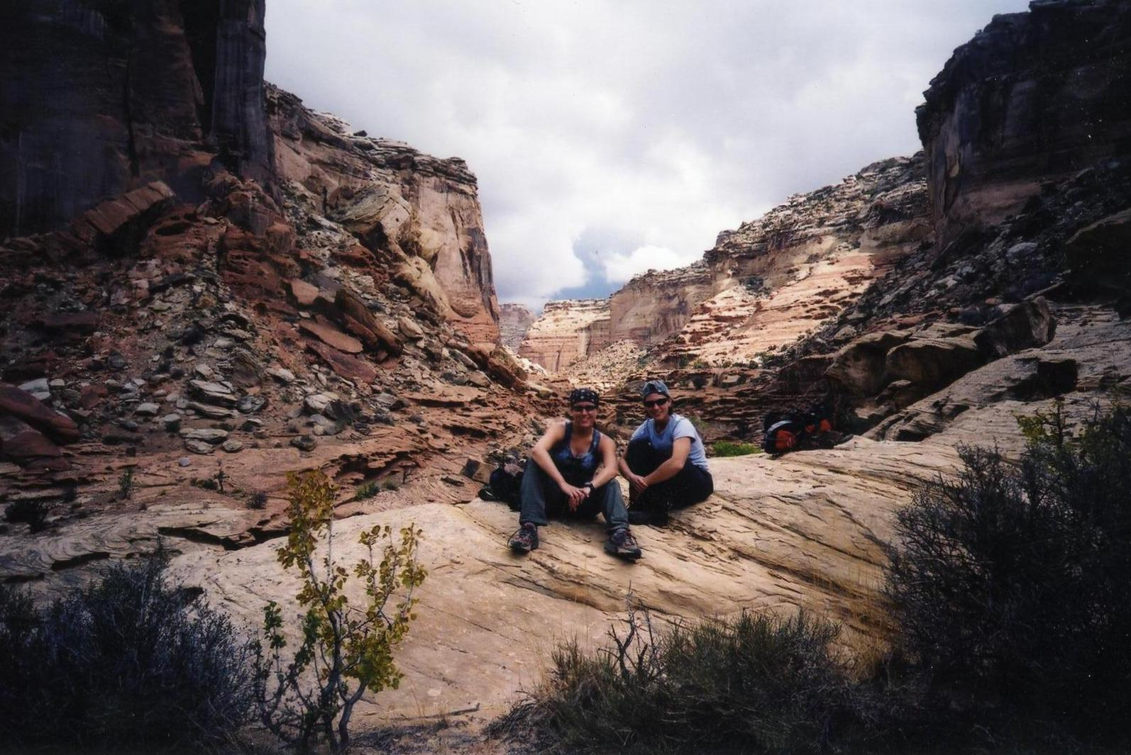 Camping with friends in the San Rafael Swell area in Utah. Here we've stopped for a rest during our day hike through one of the local canyons.