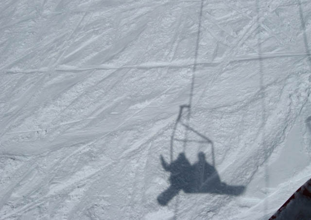 Taken from the lift over the back bowl at A-Basin – that's my husband and I enjoying some winter fun in Colorado.