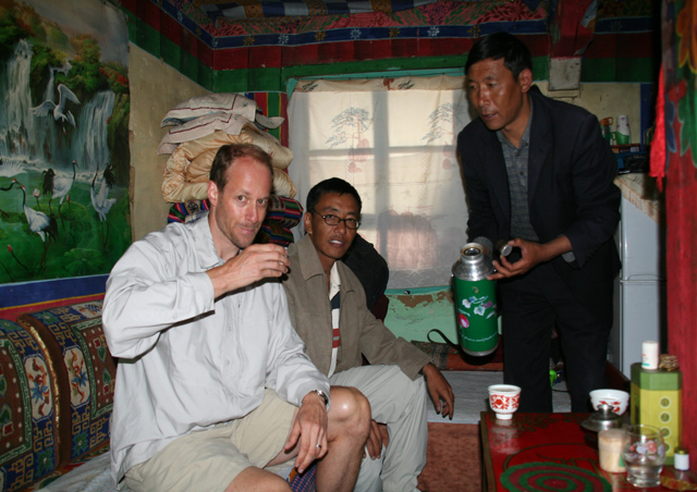 """Enjoying"" some yak butter tea in the house of a monk at a monastery in Tibet."