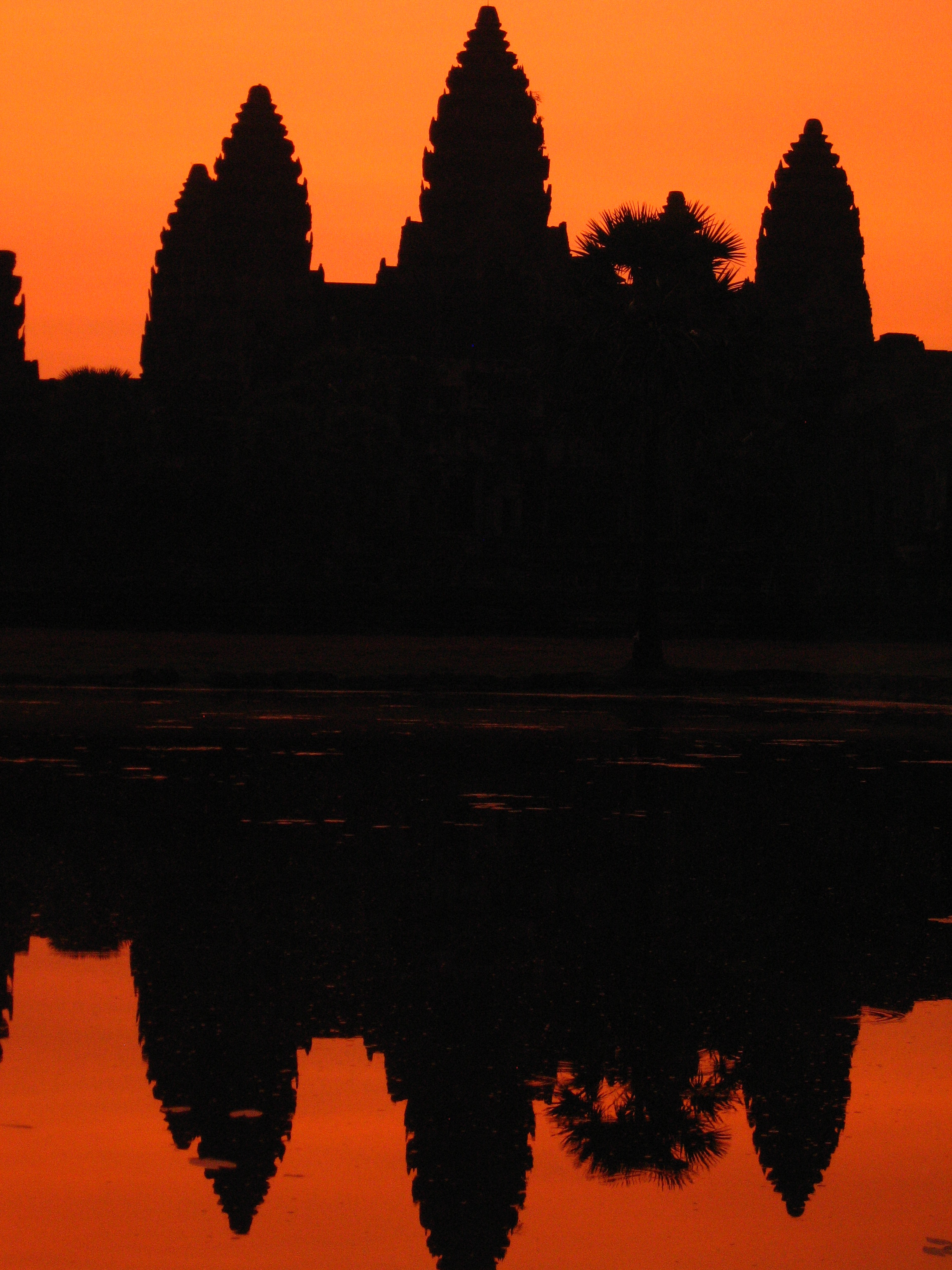 Angkor Wat was built for king Suryavarman II in the early 12th century as his state temple and capital city. Here is a shot at sunrise of Angkor Temple, the largest and best preserved monument of the Angkor complex in Cambodia.