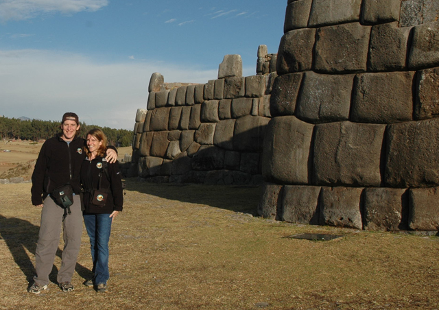 "Just outside Cusco and overlooking the city is the huge fortress of Sacsayhuaman, one of the most impressive structures you will see in Peru. The site is a marvel of construction with its massive walls and system of underground passageways. We are standing here in front of one of the ""smaller walls""."