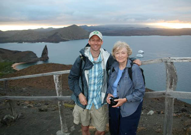 My Mom and me in the Galapagos Islands with the classic shot of Pinnacle Rock in the background (what you can't see – the 370 steps we just climbed to get there).