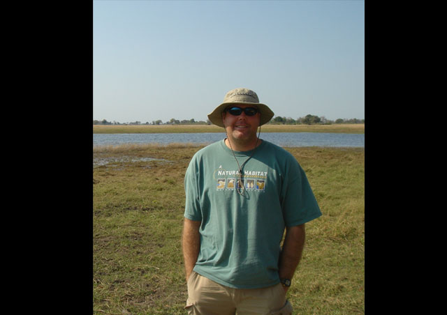 Myself in front of a watering hole we visited on one of our game drives from the Little Vumbura Camp in Botswana.