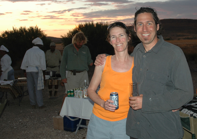 Ben and Laura enjoying a sundowner in Namibia -- one of Ben's favorite safari destinations.