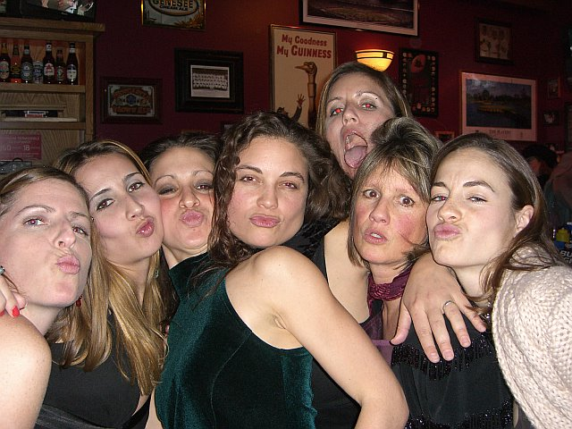 Some of the Nat Hab ladies, dressed in their finest and sending kisses at our 2006 Holiday Party.