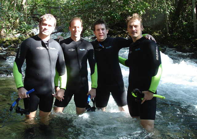 "Matt, Ricky, Greg and I in the Olho Dagua River. Bonito, Brazil. ""You know some place FUN."""