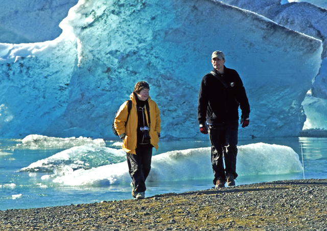 The crashing waterfalls, ice blue glaciers and picturesque fjords of Iceland are really a landscape photographers canvas. Here, a client and I are forced to abandon this deep blue glacier floating at the edge of Jokulsarlon, featured in several James Bonds movies.